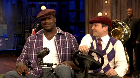 This is shaq and jimmy fallon on a golf cart together