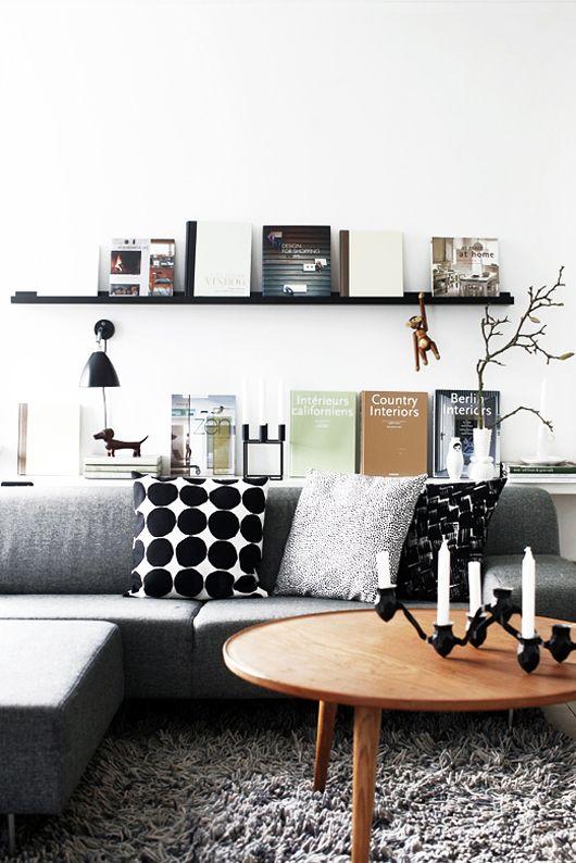 book display + floating shelf in neutral scandi-inspired living room design