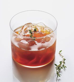 Italian Manhattan garnished with thyme