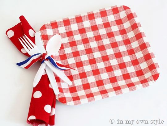 Punch hole in paper plate and tie utensils on with ribbon- love that!