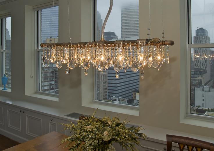McHale Brass Industrial Collection Banqueting Chandelier overlooking downtown Manhattan.