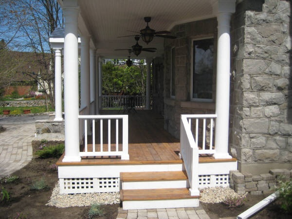 Front porch additions before and after arched canopy before during