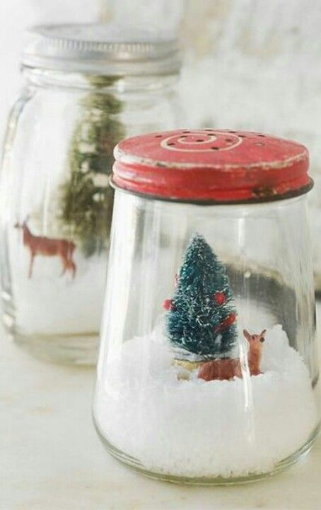 i love the idea of snowglobes in vintage containers.  if anyone knows the link to this, please post.