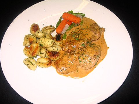 Pan-seared pork tenderloin steaks with a green peppercorn-brandy sauce ...