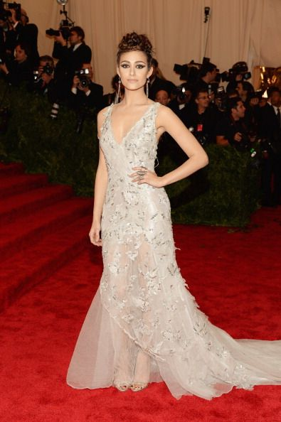 Emmy Rossum in champagne Donna Karan Atelier at the Met Gala 2013