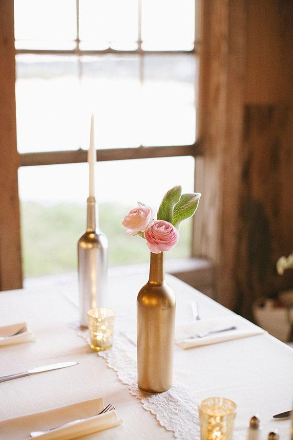 metallic silver and gold spray painted wine bottles as table decor #weddingreception #tabledecor #diy http://www.weddingchicks.com/2014/01/21/good-mood-metallic-wedding/