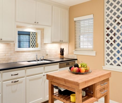 Traditional U shaped Peach kitchen, white cabinets, Sylvie Meehan,