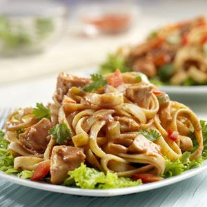 This sweet and spicy salad features cooked chicken and fettuccine ...
