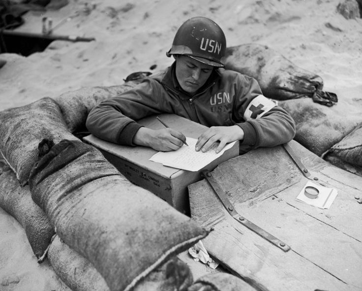 US Navy corpsman writing a letter.  (Morris Engel)
