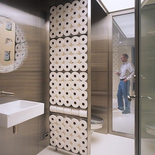 Toilet paper storage as bathroom wall art
