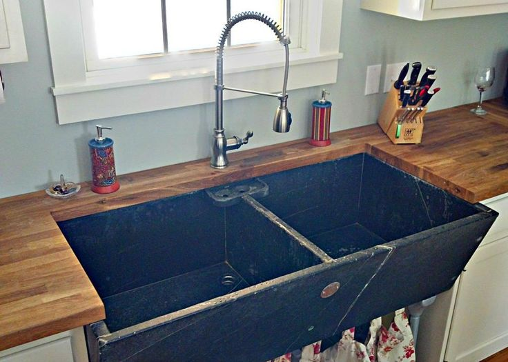 Soapstone laundry sink reused in kitchen.