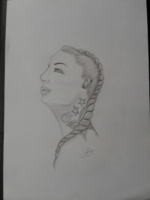 Woman with braid and tattoo drawing