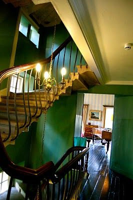 Glossy green walls with astonishingly beautiful staircase