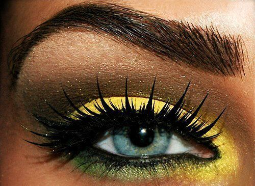 Yellow green and brown eye makeup