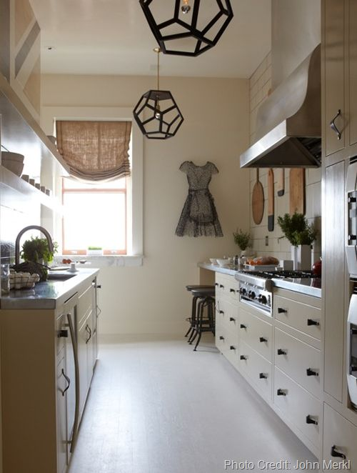 kitchen with zinc counter tops and geode pendant lamps