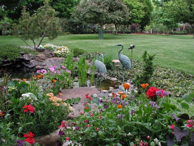 Lovely natural pond landscaping pond ideas pinterest for Natural garden pond design