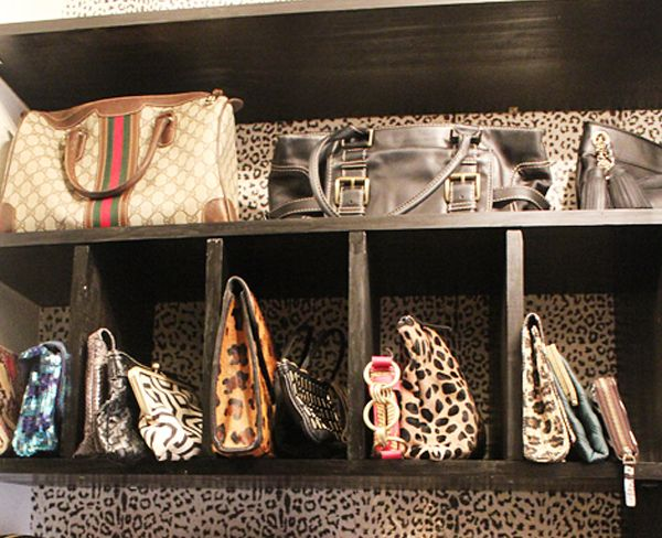 Organize purses using a bookshelf.  IKEA Expedit would work.
