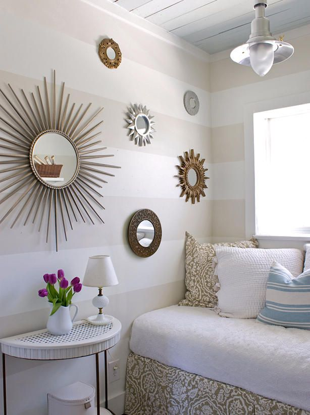 Using mirrors will add depth and dimension to a small bedroom because of their unique ability to act like additional windows. Hanging several smaller mirrors in a group can add lots of visual interest, while using one large mirror will instantly create the illusion of more square footage. Photo courtesy of Layla Palmer.