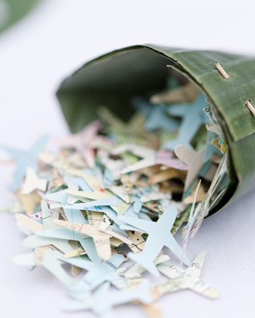 Airplane-shaped confetti punched from old maps for a destination party