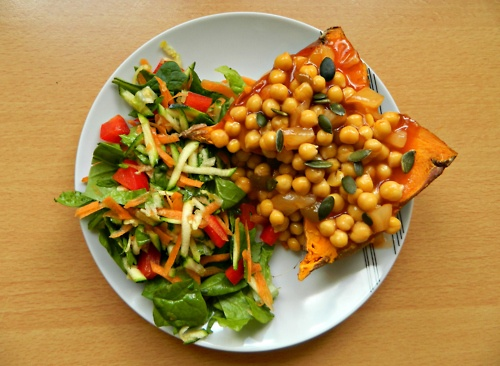 Baked sweet potato with chickpeas and pumpkin seeds in a sweet and ...