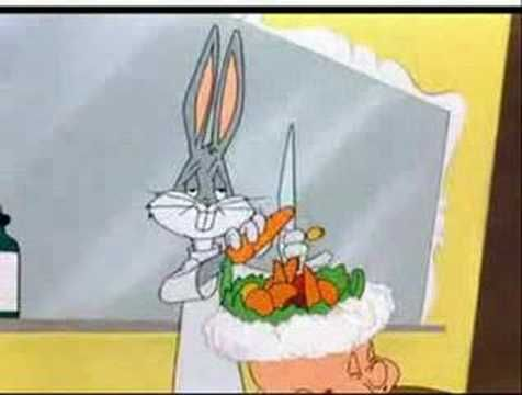 Bugs Bunny makes fruit salad on elmer fudds head