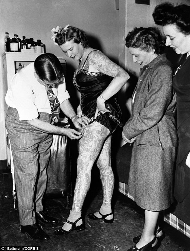 Vintage ink: By the end of the Twenties, American circuses employed more than 300 people with full-body tattoos who could earn as much as $200 per week - circus performer Betty Broadband pictured in 1947 in Manhattan