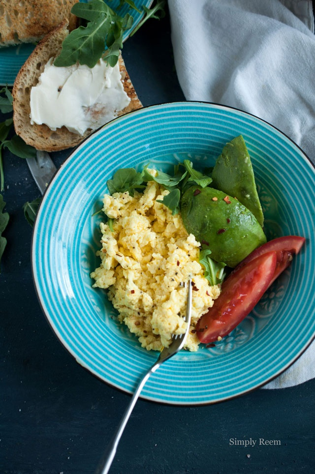 simple breakfast - scrambled eggs, arugula, tomato, avocado & toast.