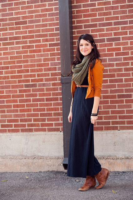 Style a maxi dress for fall with a scarf, cardigan, and boots.