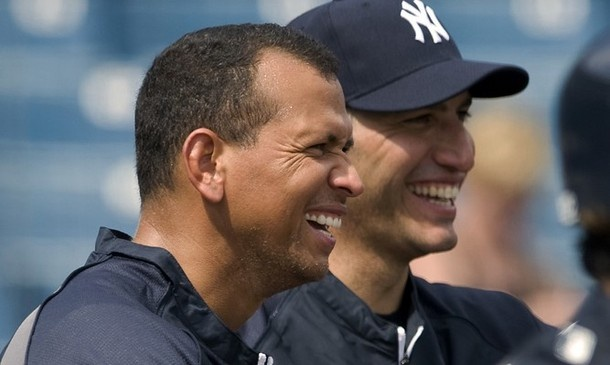 New York Yankees' Alex Rodriguez (L) and Andy Pettitte watch batting practice