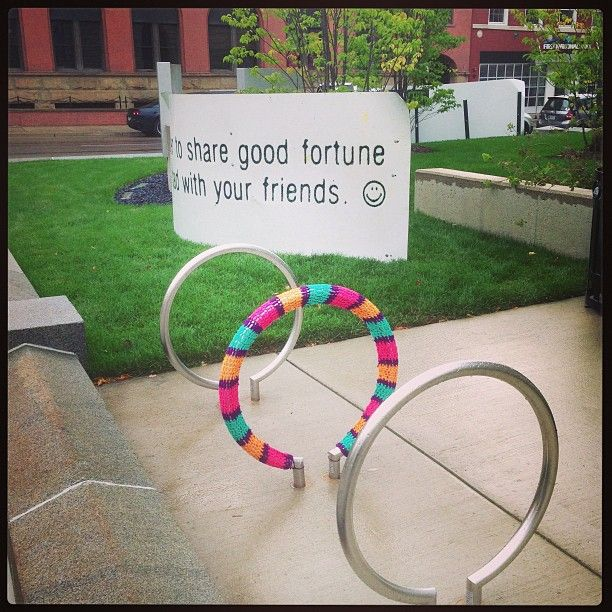 """Remember to share good fortune as well as bad with your friends."" -- I don't know which is more awesome here ... the enormous fortune cookie fortune or the accompanying #yarnbomb! http://knithacker.com/?p=9254 #knit"