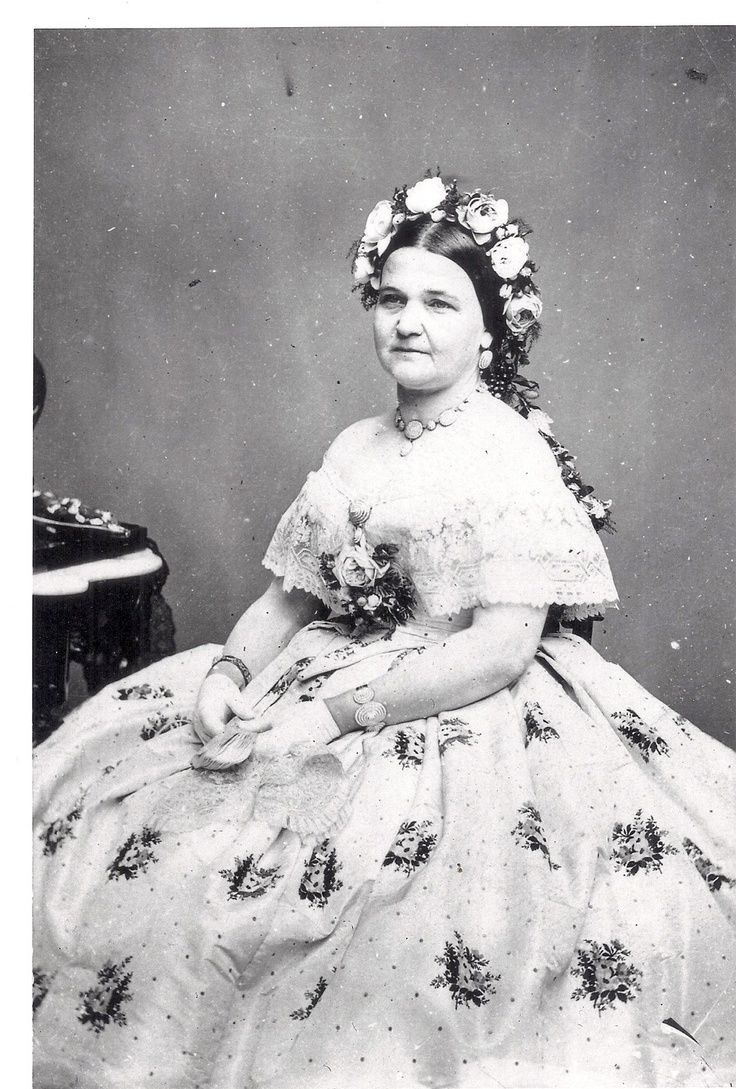 Seated Mary Todd Lincoln portrait wearing another of her fine gowns and her favorite seed peal necklace and bracelets. She wears this jewelry set in several of her portrait sittings. Check other portraits of her to see if you can find her wearing this jewelry set. She wore them quite often.