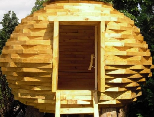 backyard beehive treehouse or pretty way to make a pythy hiding place