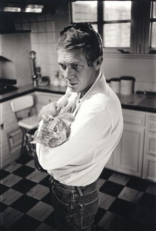 "Steve McQueen and his family cat, ""Kitty Cat,"" 1964"