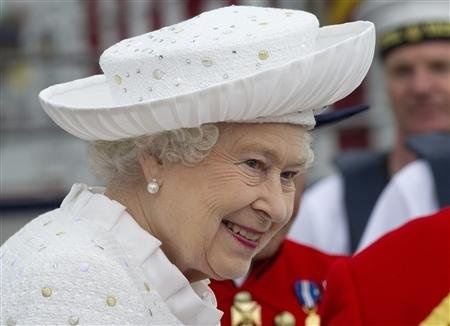 Britain's Queen Elizabeth embarks from Chelsea Harbour to join the pageant on the River Thames, in London