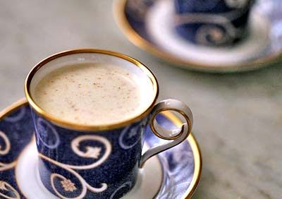 Traditional holiday eggnog recipe with eggs, milk, cream, nutmeg, and ...