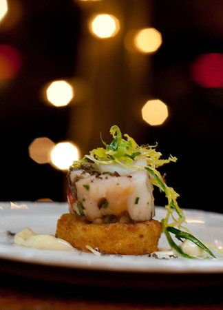 Lobster and mushroom terrine on a crisp rosti potato, shaved brussel ...