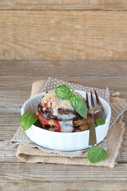 Eggplant and tomato sauce gratin with mozzarella cheese and parmesan