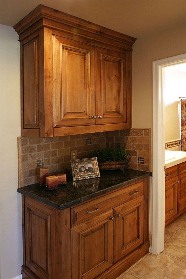 Knotty alder bathroom solano style linen cabinet stone creek