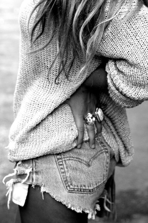 riped jean shorts chunky jewels and sweater.... fab.