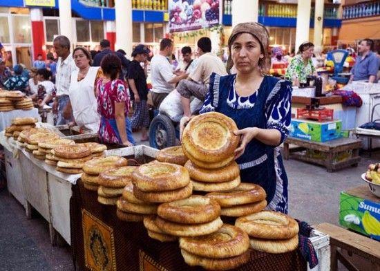 A woman sells bread at a market in Tajikistan #travel