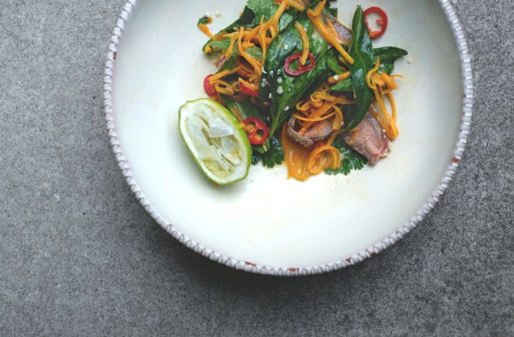 Raw pumpkin and herb salad with lime-coconut dressing and seared beef ...