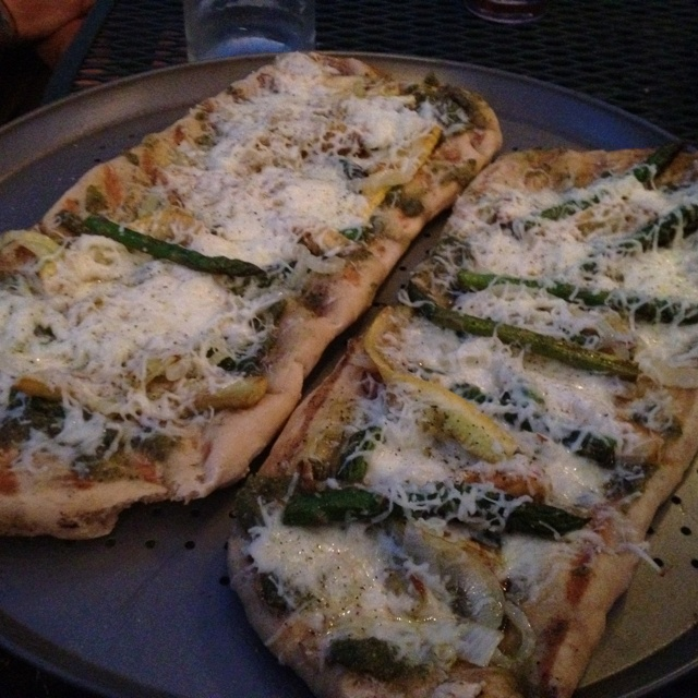 Grilled pizza with caramelized onions, yellow squash, asparagus and ...