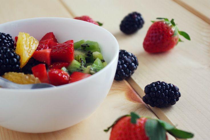 bowl of pomegranate yogurt topped with fresh fruit. #glutenfree # ...
