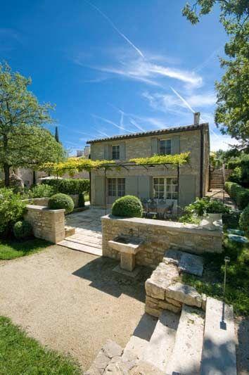 great stone terrace and pergola