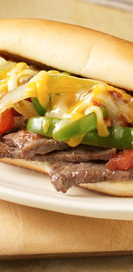 Tender strips of steak, spicy vegetables and Colby Jack cheese stuffed ...