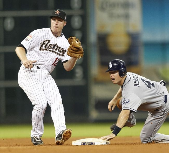 Game #74 6/25/12: Nick Hundley #4 of the San Diego Padres slides safely into second base as Brian Bixler #12 of the Houston Astros applies the tag at Minute Maid Park on June 25, 2012 in Houston, Texas. (Photo by Bob Levey/Getty Images)