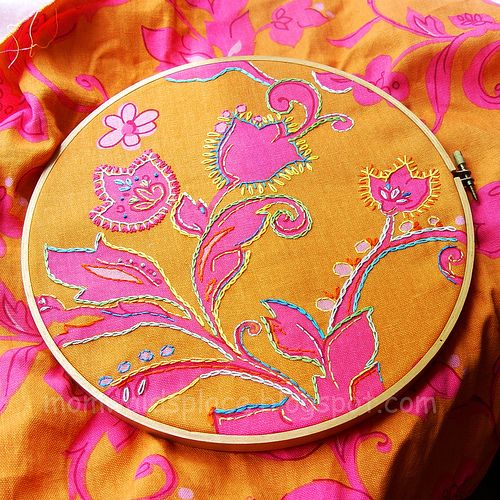 want to try this for fun - embellishing printed fabric with embroidery
