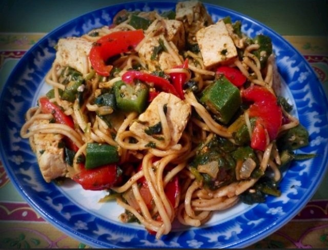 Stir fried noodles with tofu, okra, red bell peppers, rapini, spinach ...
