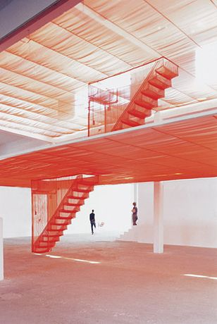 "Do Ho Suh, ""Staircase-IV,"" 2004  a site-specific installation meticulously stitched out of a translucent red nylon."