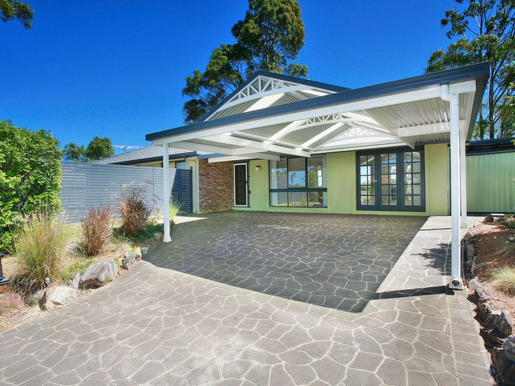 Carports on sloping driveways pictures for Cool carport designs
